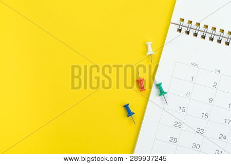 Flat Lay Or Top View Of Clean White Calendar With Thumbtack Or Pushpin On Vivid Yellow Background Wi