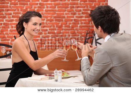 Elegant couple dating in a restaurant