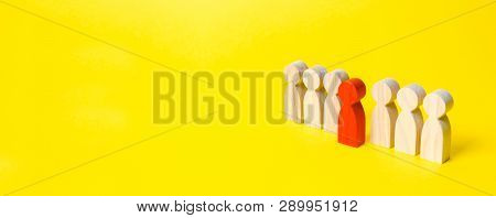 The Red Figure Of A Man Comes Out Of A Line Of People On A Yellow Background. Leader Concept And Lea