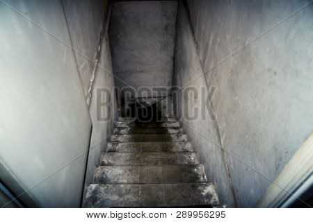 The Descent To The Basement Of The Old Concrete Stairs. The Image Is Blurred And Discolored To Give