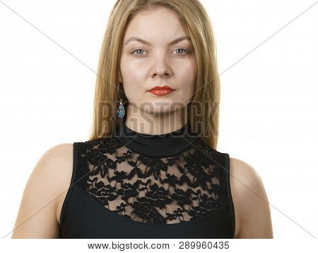 Blonde Woman Wearing Black Top With Laced Detail On Cleavage. Fashion, Clothing Style Concept.