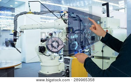 The Engineer Uses A Futuristic Projection Touch Screen To Control Robots In A Smart Factory. Smart I