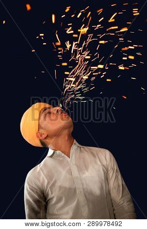 Bikaner, India - January 12, 2019: Indian Fakir, Fire Eater Performing Fire Eating Tricks During Cam