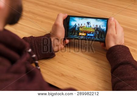 Prague, Czech Republic - March 16, 2019: Man Holding A Smartphone And Playng The Playerunknown S Bat