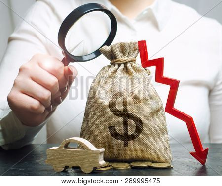 A Manager Is Holding A Magnifying Glass Over A Money Bag, A Car And A Down Arrow. Falling Cost Of Ma