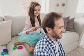 Close up photo little she her girl glad he him his father hair make daddy cool coiffure hair brushing glad to be useful sunday homey wear jeans denim checkered plaid shirt house sit cozy divan poster