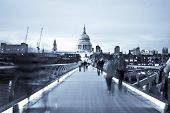 Blurred people on the Millennium bridge, London. poster