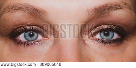 Female Eyes. Freckles Skin. Mascara On The Eyelashes. Iris Close Up