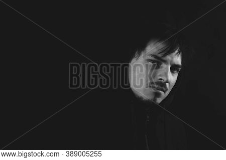 Young Man In The Dark. Male Portrait. Black And White