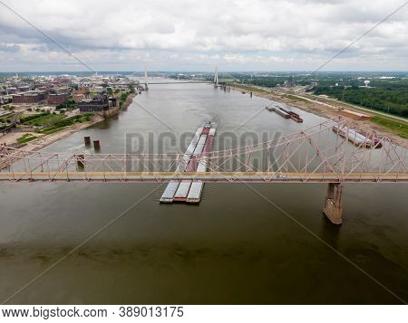 August 28, 2020 - St Louis, Missouri, USA: Aerial views of the city of St. Louis, Missouri with the St. Louis Arch and a barge on the Mississippi River