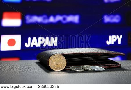 Japanese Ten Yen Coins On Obverse (jpy) And Pile Of Other Japanese Coins On Black Floor With Black W