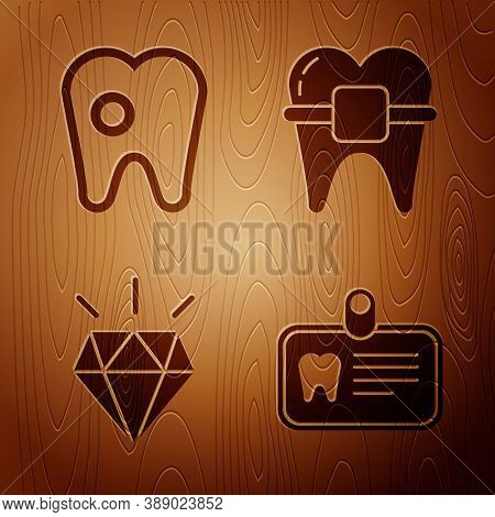Set Id Card With Tooth, Tooth With Caries, Diamond Teeth And Teeth With Braces On Wooden Background.