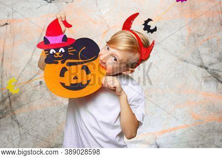 Boy Nibbles Pumpkin From Halloween Boy Nibbles Pumpkin From Halloween
