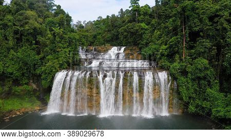 Beautiful Waterfall In Green Forest, Top View. Tropical Tinuy-an Falls In Mountain Jungle, Philippin
