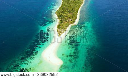 Travel Concept: Sandy Beach On A Small Island Little Santa Cruz By Coral Reef Atoll From Above. Zamb