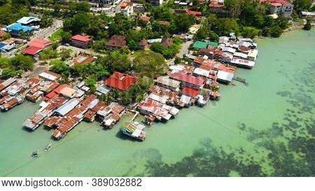 Village Of Fishermen With Houses On The Water, With Fishing Boats In Tagbilaran City. Bohol, Philipp