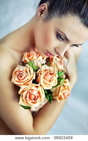 Naked beauty holding roses