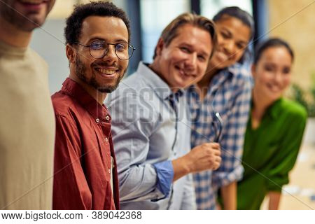 Successful Team. Group Of Young Happy Multi Ethnic Business Team Looking At Camera And Smiling While