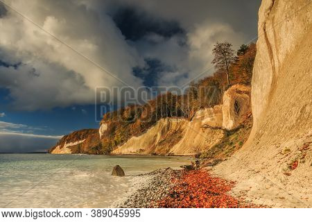 Chalk Cliffs With Pirate Bay On The Island Of Ruegen. Sunshine On The Coast In Autumn With Clouds An