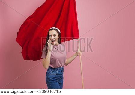 Activist And Revolutionary, Young Woman With A Red Flag On A Pink Background. Feminism And The Strug