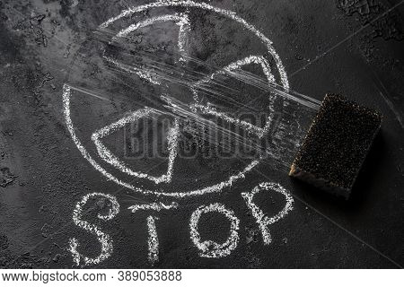 Sponge-erased Nuclear Weapon Symbol And Stop Inscription. Concept Of Renunciation Of Nuclear Weapons