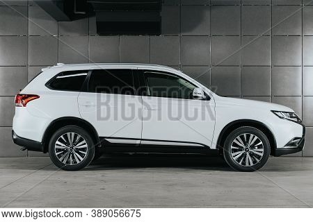 Novosibirsk, Russia - October 08, 2020: White Mitsubishi Outlander, Side View.  Photography Of A Mod