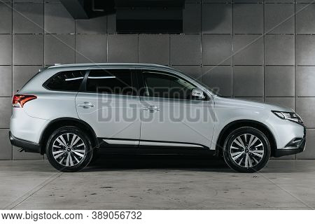 Novosibirsk, Russia - October 08, 2020: Gray Mitsubishi Outlander, Side View.  Photography Of A Mode