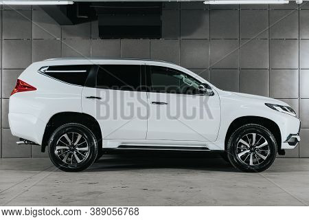 Novosibirsk, Russia - October 08, 2020:  White Mitsubishi Pajero Sport,  Side View.  Photography Of