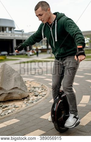 Man Riding Electric Mono Cycle On Street