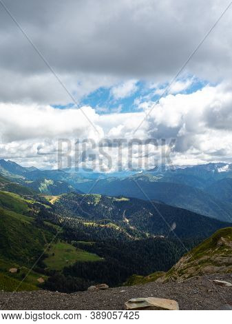 View From The Top Of The Mountain Valley, Beautiful Mountain Landscape. High-mountain Massif, Clouds