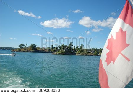 Water, Lake, Islands, Green Trees, Recreation Buildings Clouds Sky Flag Boat Trip