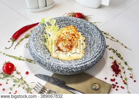 Chicken Cutlets With Mashed Potatoes In A Marble Plate On A Table In A Restaurant. Decor. Selective