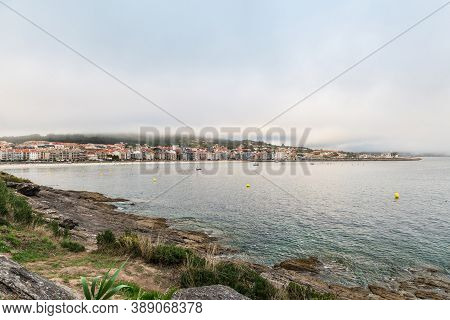 Panorama View Of Sanxenxo And Silgar Beach At The End Of A Cloudy Summer Day In The Rias Baixas In G
