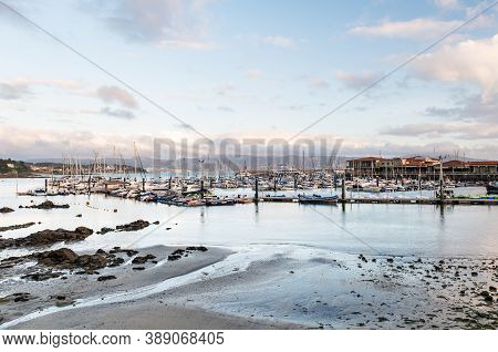 Panorama View Of The Yacht Club Of Sanxenxo Full Of Small Sailing Boats On A Cloudy Summer Day, Pont