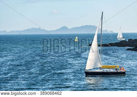 Portonovo, Spain - August 15, 2020: A Small Boat Sails Away From The Ria De Pontevedra In Galicia At