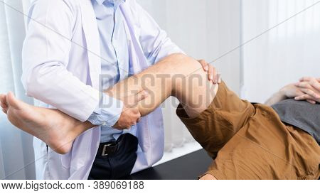Physiotherapist Doctor Rehabilitation Consulting Physiotherapy Giving Exercising Knee Treatment With