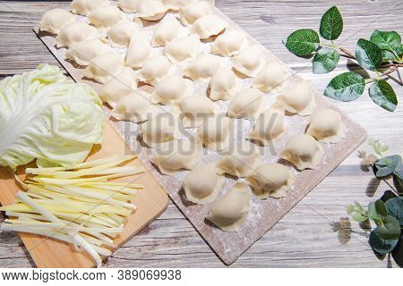 Boiled Dumpling Is Chinese Dumplings Or Potstickers In Boiling Water. Dumpling Is A Dough And Wrappe