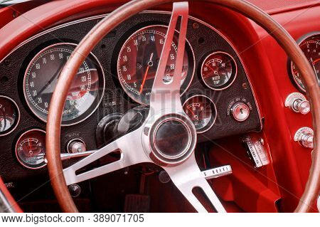 Part Of Interior With Speedometer, Revs, Fuel, Oil, Water Temperature And Battery Dials And Knobs On