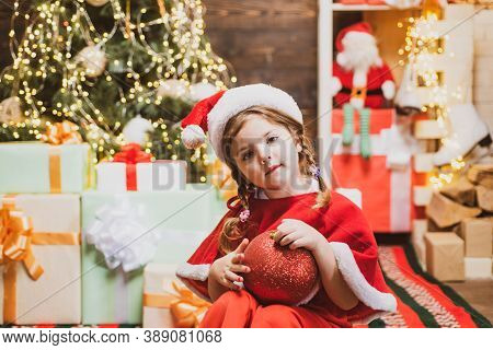 Happy Cute Child In Santa Hat With Present Have A Christmas. Christmas Children. Christmas Child Hol