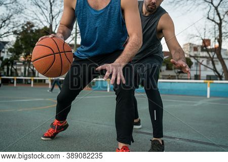 Young Basketball Players Playing One-on-one.