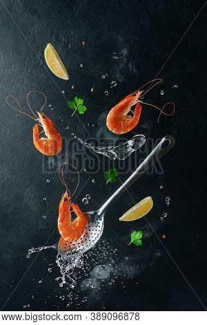 Flying Tiger Shrimps With Ingredients Over Skimmer And Boiled Water. Creative Design Of Seafood Cook