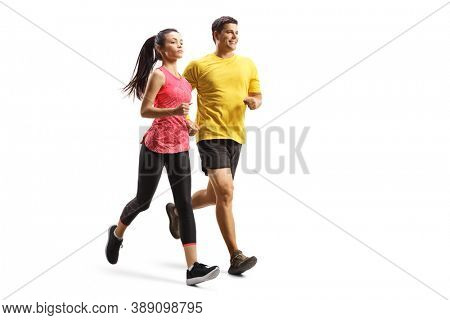 Full length shot of a young man and woman in sportswear jogging isolated on white background