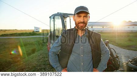 Portrait Of Young Caucasian Handsome Happy Man Farmer Standing In Field And Smiling To Camera. Big T