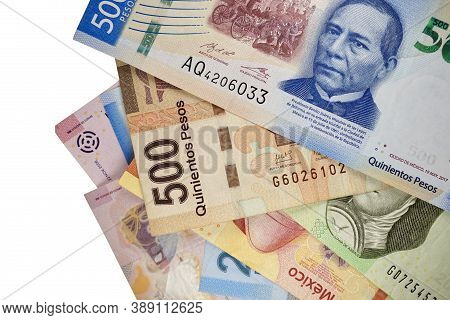 Some Mexican Peso Bills Isolated On White Background