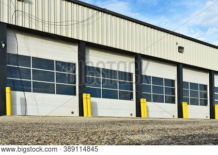 An Image Of A Closed Overhead Door On An Industrial Building.