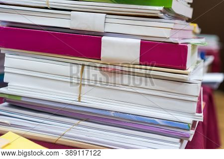 Pile Of Books And Documents Report Papers Waiting Be Managed On Desk In Busy Office. Concept Of Work