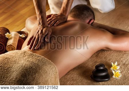 Massage Treatment - Neck And Whole Body Massage By Woman. Doing Massaging Using Oil. Neck And Whole