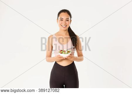 Sport, Wellbeing And Active Lifestyle Concept. Portrait Happy Asian Female Athlete, Fitness Girl Smi
