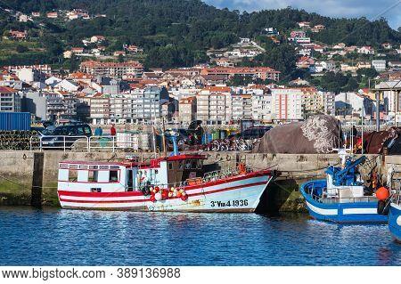 Portonovo, Spain - August 15, 2020: Colorful Small Fishing Boats Moored In Portonovo Port At Dusk, G