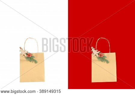 Close Up Paper Brown Bag With Wooden Clip With Green Leaf Of Pines And Branche Of Small Red Fruit In